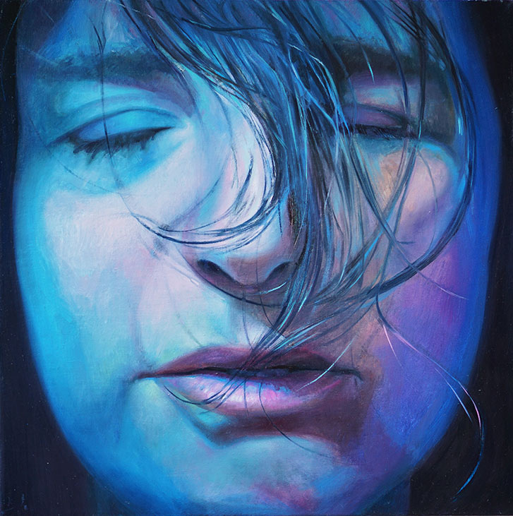 Hair flows over the blue portrait painting