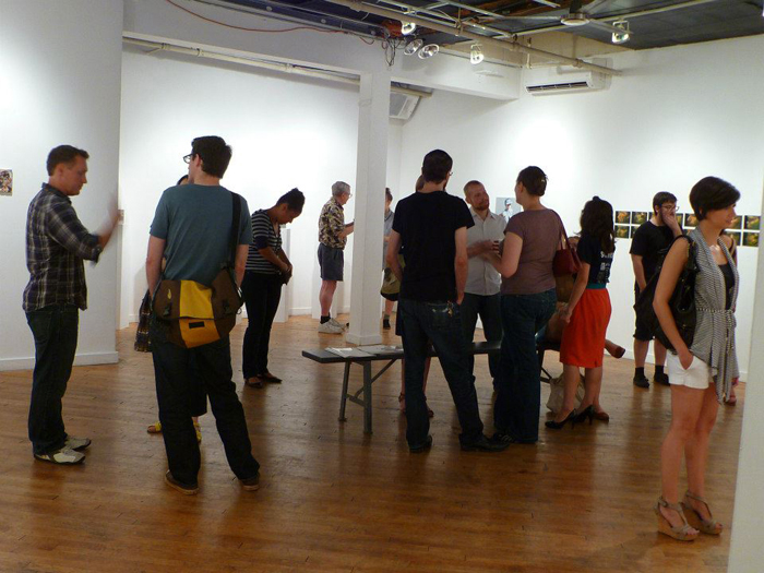 "A crowd of people in front of my artwork titled ""overlap"" at the Brooklyn at space."